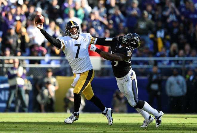 Pittsburgh Steelers quarterback Ben Roethlisberger (7) throws a pass as he tries to avoid Baltimore Ravens outside linebacker Matt Judon in the first half of an NFL football game, Sunday, Nov. 4, 2018, in Baltimore. (AP Photo/Gail Burton)