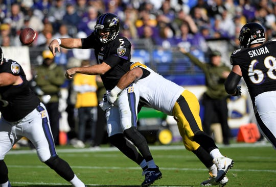 Baltimore Ravens quarterback Joe Flacco (5) throws a pass as he is pressured in the first half of an NFL football game against the Pittsburgh Steelers, Sunday, Nov. 4, 2018, in Baltimore. (AP Photo/Nick Wass)
