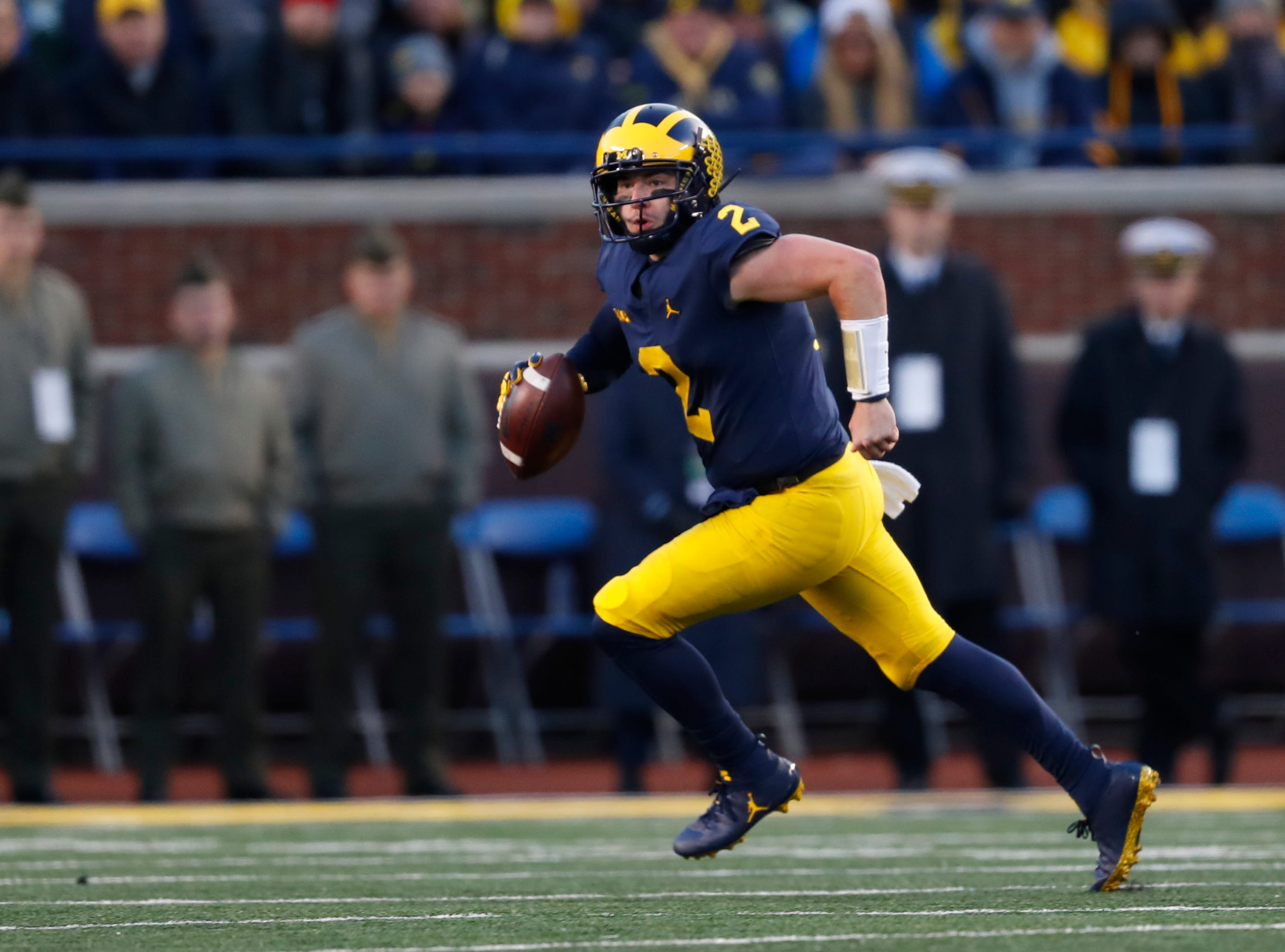 Michigan quarterback Shea Patterson runs against the Penn State in the second half of an NCAA college football game in Ann Arbor, Mich., Saturday, Nov. 3, 2018. (AP Photo/Paul Sancya)