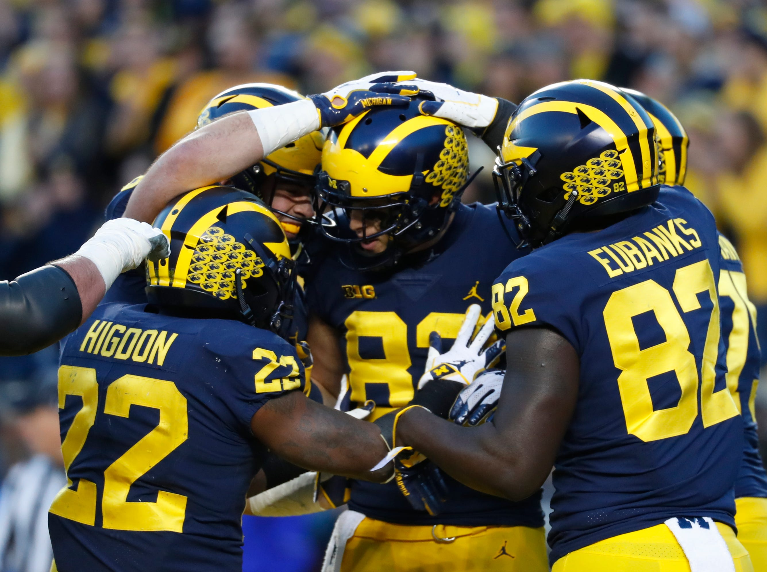 Michigan tight end Zach Gentry (83) celebrates his even-yard touchdown reception with teammates in the second half of an NCAA college football game against Penn State in Ann Arbor, Mich., Saturday, Nov. 3, 2018. (AP Photo/Paul Sancya)