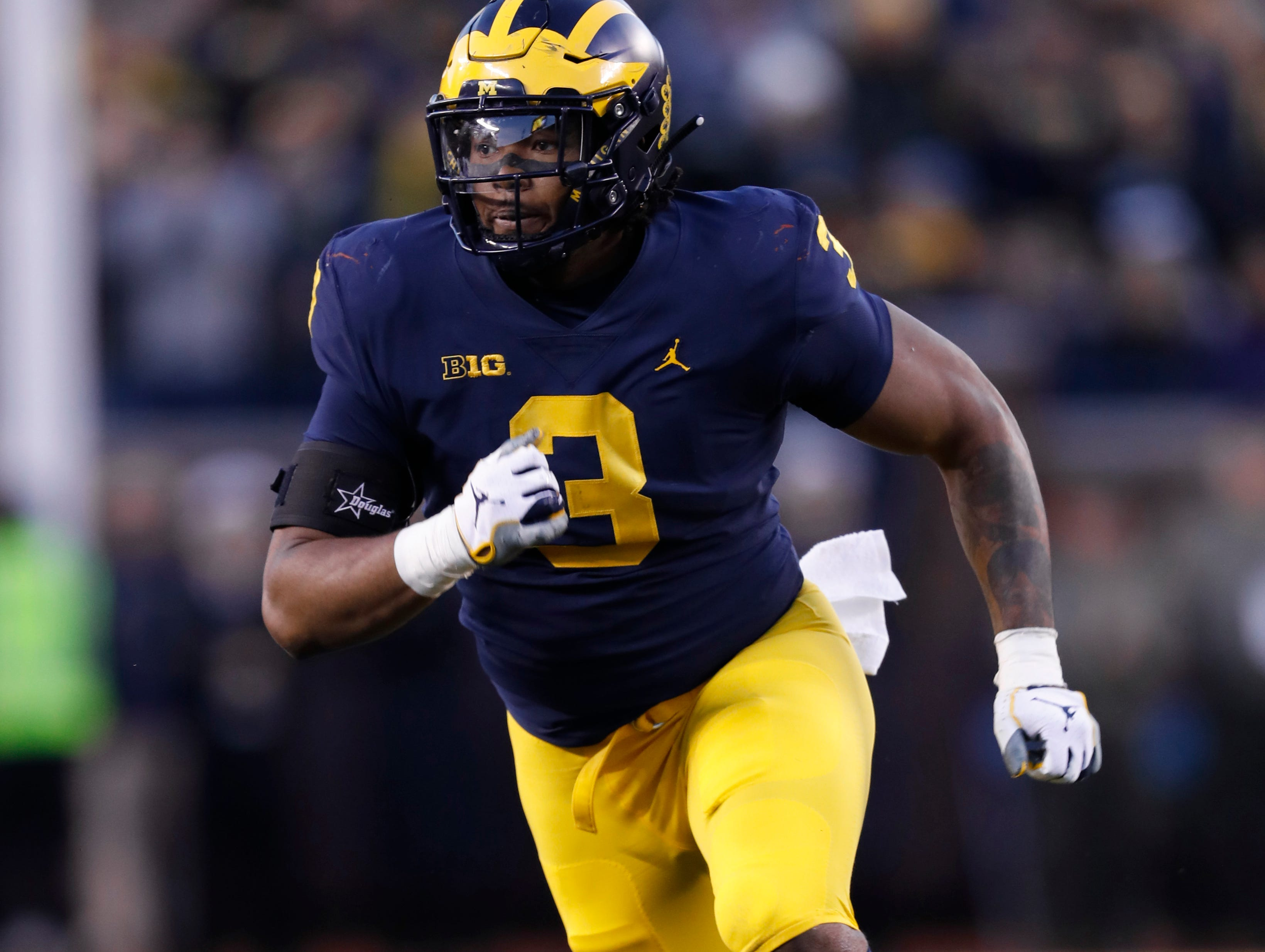 Michigan defensive lineman Rashan Gary plays against Penn State in the second half of an NCAA college football game in Ann Arbor, Mich., Saturday, Nov. 3, 2018. (AP Photo/Paul Sancya)