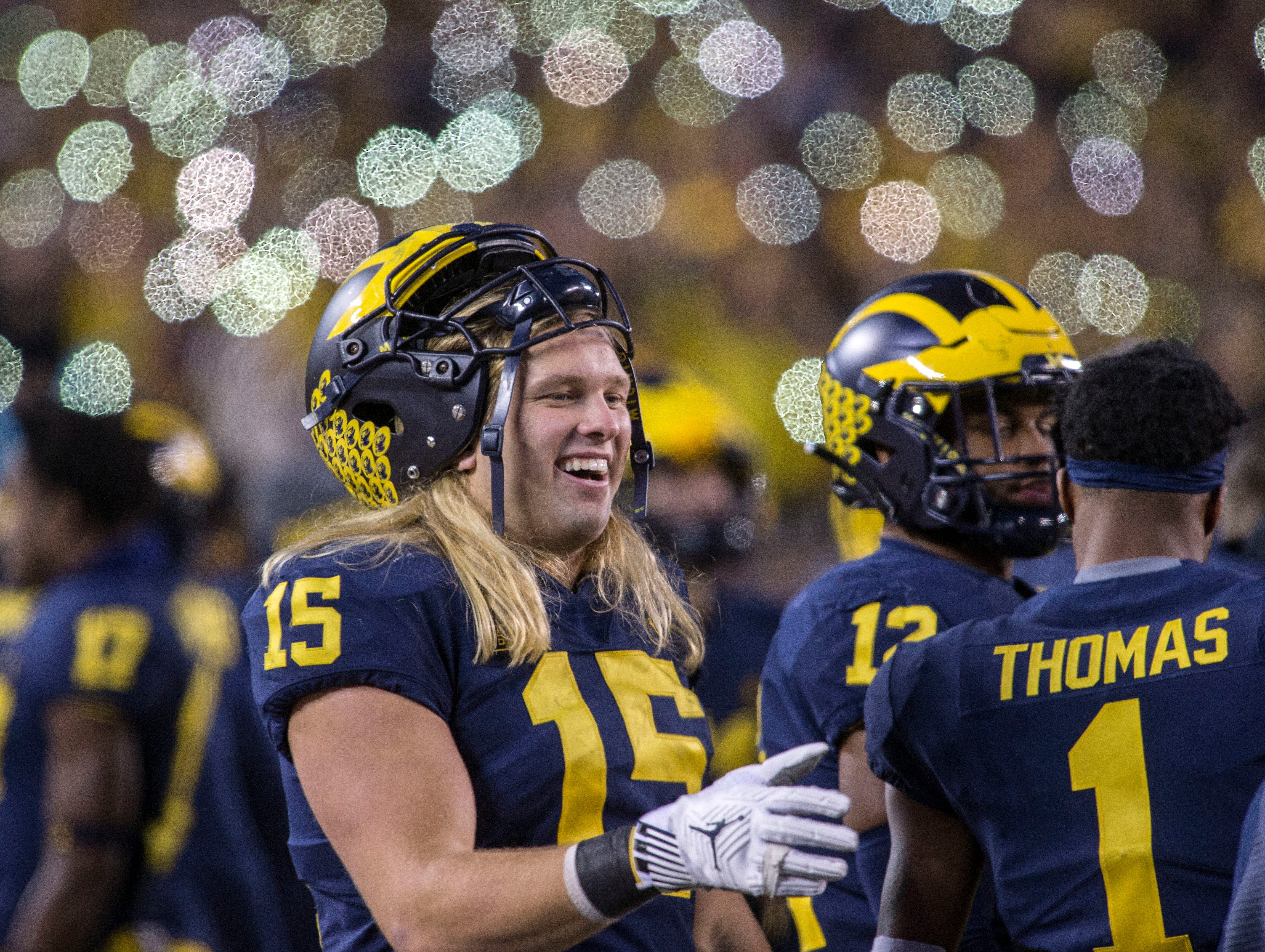 Michigan defensive lineman Chase Winovich (15) walks his bench area in the fourth quarter of an NCAA college football game against Penn State in Ann Arbor, Mich., Saturday, Nov. 3, 2018. Michigan won 42-7. (AP Photo/Tony Ding)