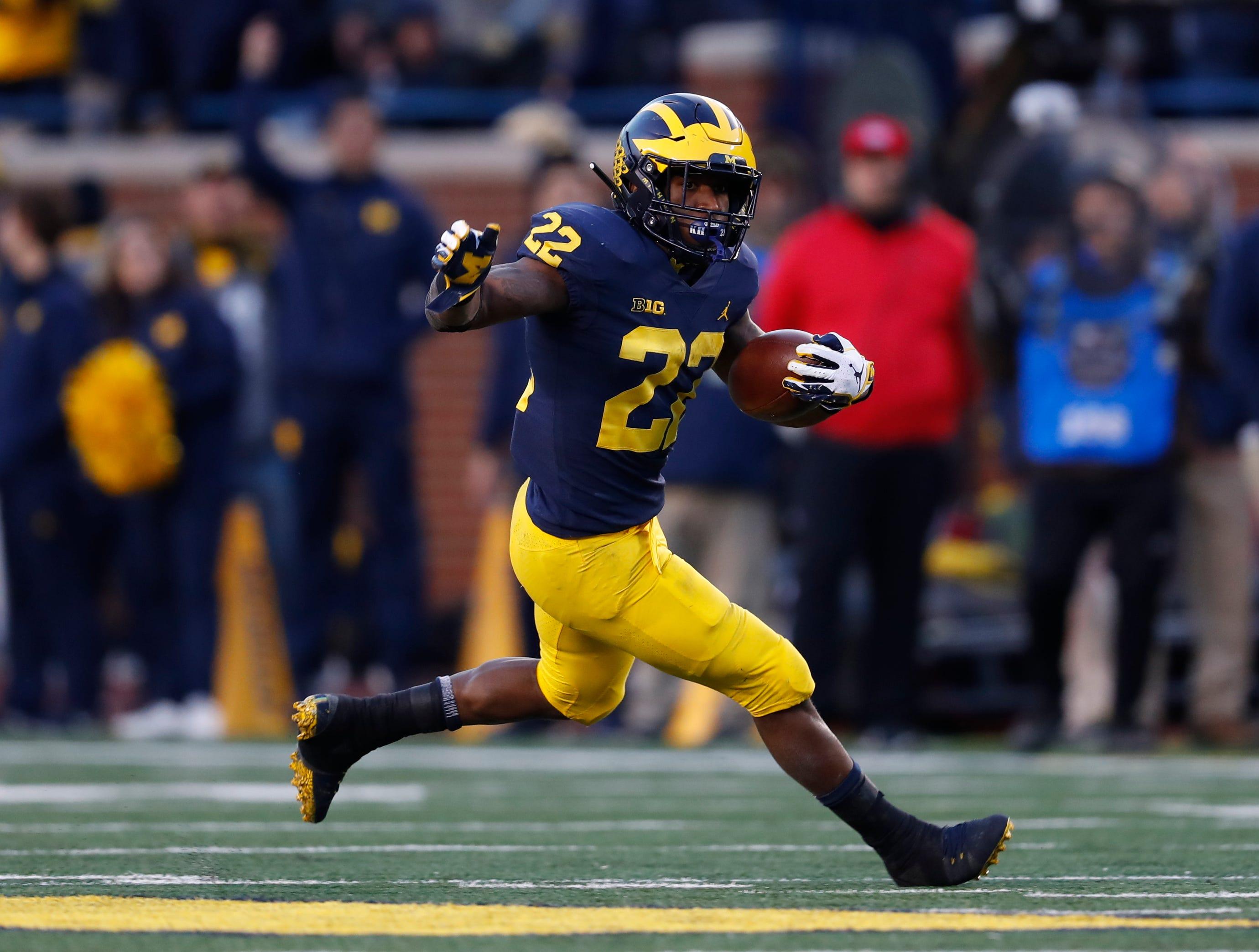 Michigan running back Karan Higdon runs against Penn State in the second half of an NCAA college football game in Ann Arbor, Mich., Saturday, Nov. 3, 2018. (AP Photo/Paul Sancya)