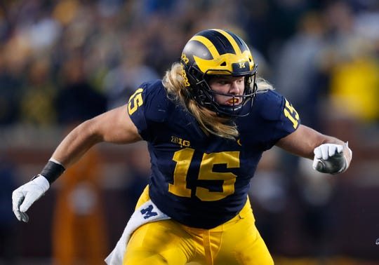 Michigan defensive lineman Chase Winovich plays against Penn State in the second half of an NCAA college football game in Ann Arbor, Mich., Saturday, Nov. 3, 2018. (AP Photo/Paul Sancya)