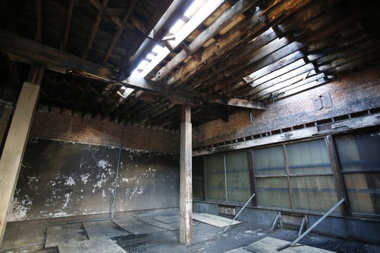 A hole in the roof has yet to be repaired at the vacant 190 E. Main St. building, part of the old Renaissance Square block.