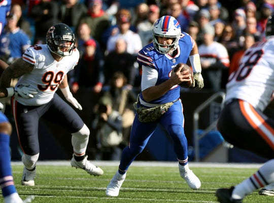 Bills quarterback Nathan Peterman  is pressured by Bears Aaron Lynch.