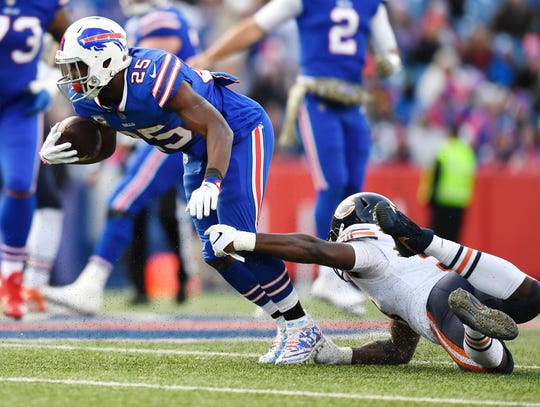 Buffalo Bills running back LeSean McCoy (25) is tackled by Chicago Bears' Roquan Smith (58) during the second half of an NFL football game Sunday, Nov. 4, 2018, in Orchard Park, N.Y. (AP Photo/Adrian Kraus)