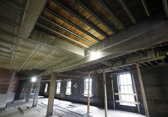 Part of the old tin ceiling remains intact inside 190 E. Main St., part of the old Renaissance Square block.