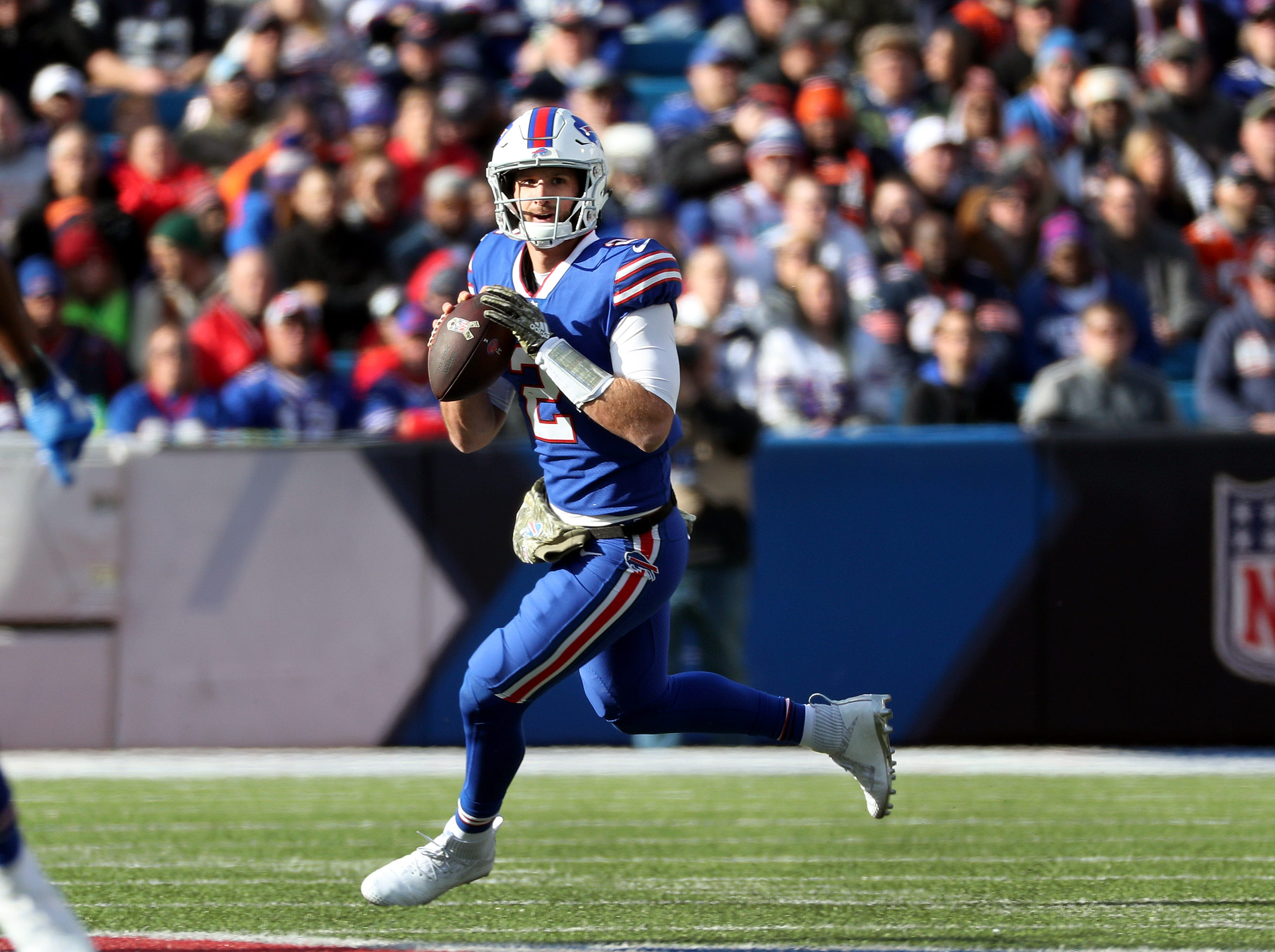 Bills quarterback Nathan Peterman rolls to his right as he looks downfield.