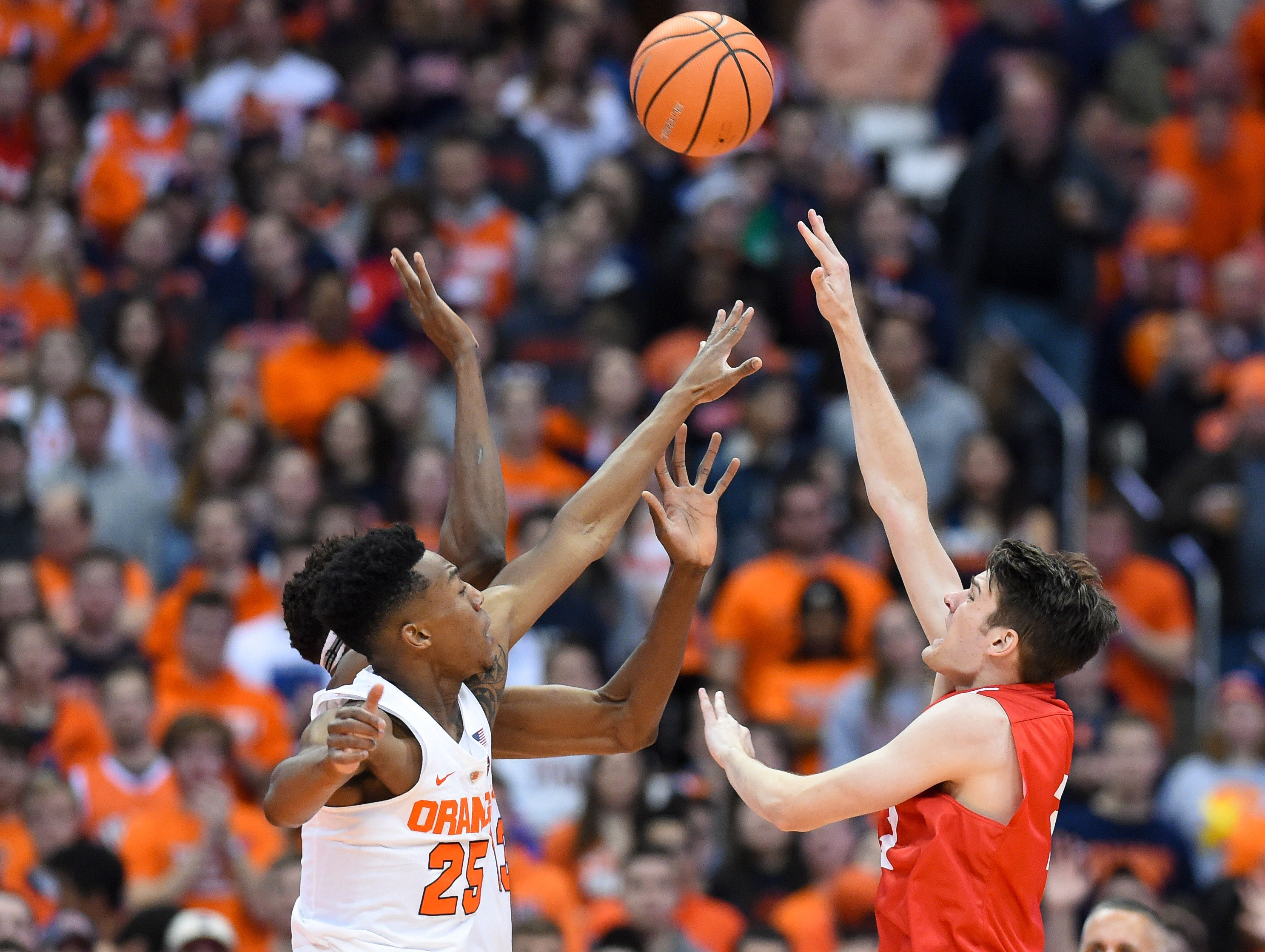 Nov 10, 2017; Syracuse, NY, USA; Cornell Big Red forward Jimmy Boeheim (3) shoots the ball as Syracuse Orange guard Tyus Battle (25) defends during the first half at the Carrier Dome. Mandatory Credit: Rich Barnes-USA TODAY Sports
