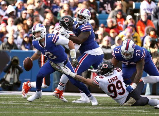 Bills quarterback Nathan Peterman tries to break free of Chicago's Aaron Lynch.