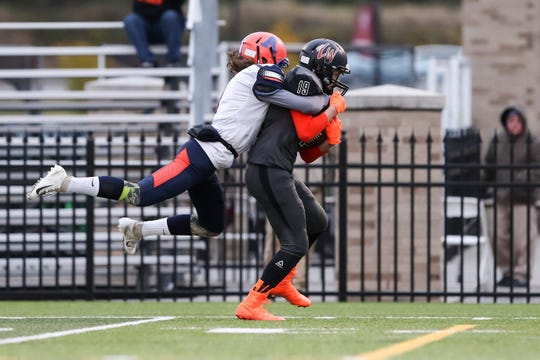 November 3, 2018; Pittsford, NY; USA; Letchworth/Warsaw wide receiver Eddie Stores (19) is tackled from behind by  Attica linebacker Mitchell Cook (1) during the Section V Class C championship high school football game at St. John Fisher College.  Photo: Christopher Cecere