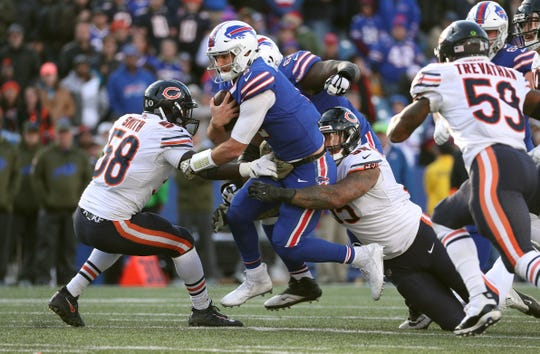 Bills quarterback Nathan Peterman was pressured much of the day in a 41-9 loss to the Bears.