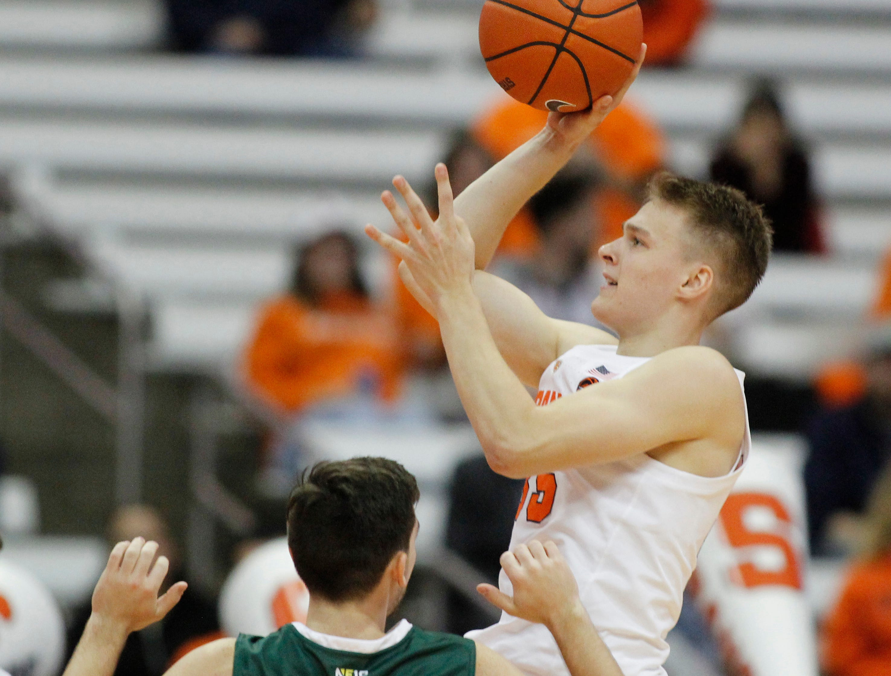 Syracuse's Buddy Boeheim, right, shoots over Le Moyne's Wyatt Self, left, during the second half of a preseason NCAA college basketball game in Syracuse, N.Y., Wednesday, Oct. 31, 2018. Syracuse won 89-52. (AP Photo/Nick Lisi)