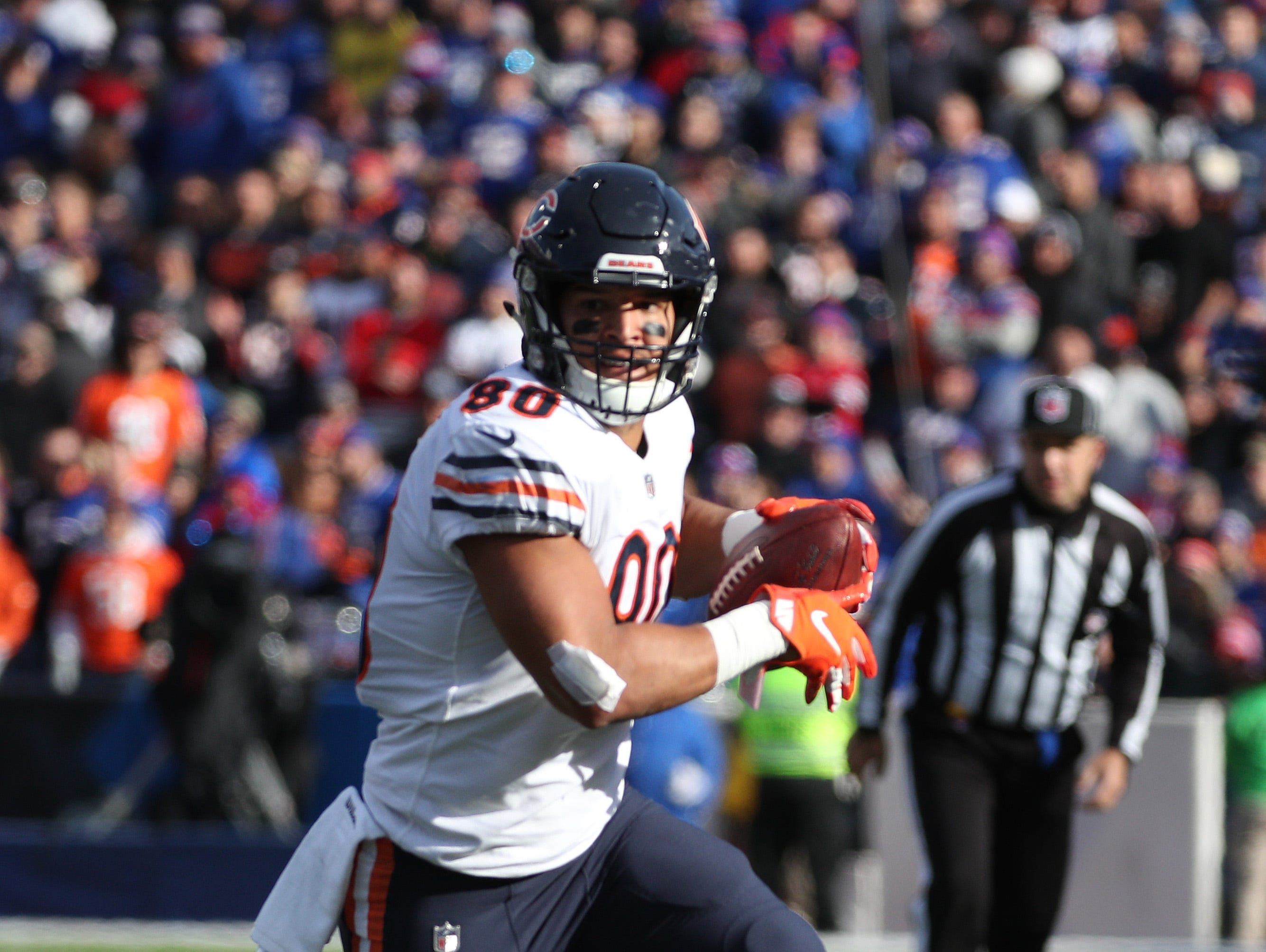Bears tight end Trey Burton looks for running room after a catch.