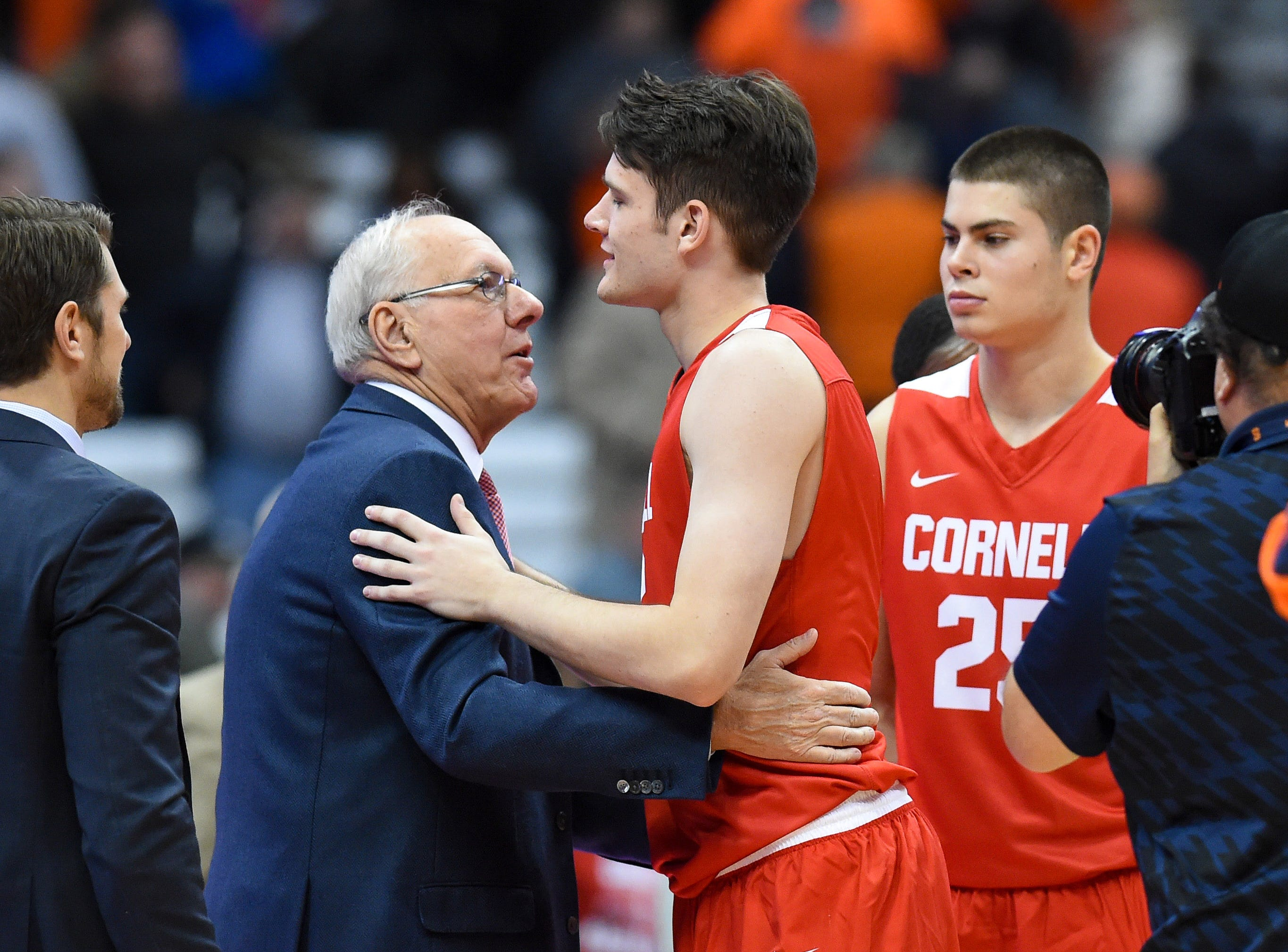 Nov 10, 2017; Syracuse, NY, USA; Syracuse Orange head coach Jim Boeheim greets his son Cornell Big Red forward Jimmy Boeheim (3) following the game at the Carrier Dome. Mandatory Credit: Rich Barnes-USA TODAY Sports