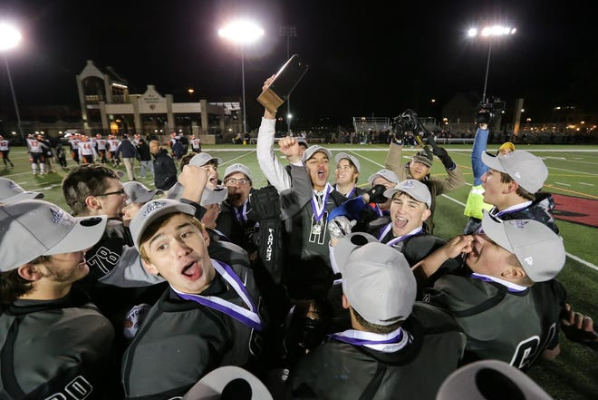November 3, 2018; Pittsford, NY; USA; The Letchworth/Warsaw team celebrates their Section V Class C championship against the Attica Blue Devills at St. John Fisher College.