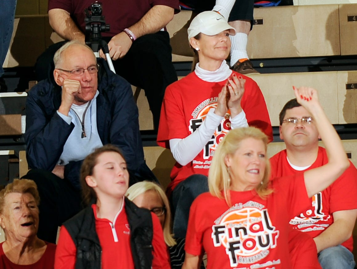 Syracuse basketball coach Jim Boeheim and his wife Juli Boeheim ,top, watch their daughter Jamie Boeheim who plays for Jamesville-DeWitt play Williamsville South in the New York State Public High School Athletic Association girls' Class A championship basketball game on Saturday, March 21, 2015, in Troy, N.Y.