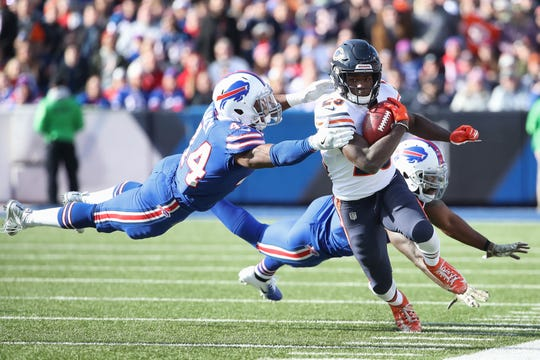 BUFFALO, NY - NOVEMBER 04: Tarik Cohen #29 of the Chicago Bears runs back a punt as Deon Lacey #44 of the Buffalo Bills dives to make a tackle in the first quarter during NFL game action at New Era Field on November 4, 2018 in Buffalo, New York. (Photo by Tom Szczerbowski/Getty Images)