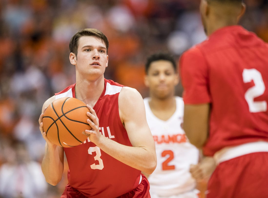 Jimmy Boeheim #3 of the Cornell Big Red handles the ball during the first half against the Syracuse Orange at the Carrier Dome on November 10, 2017 in Syracuse, New York.