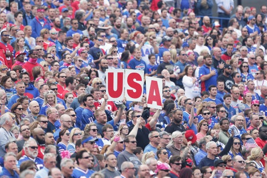 "Fans hold up a ""USA"" sign during the national anthem before the game against the San Francisco 49ers and the Buffalo Bills during the first half at New Era Field on October 16, 2016 in Buffalo, New York."