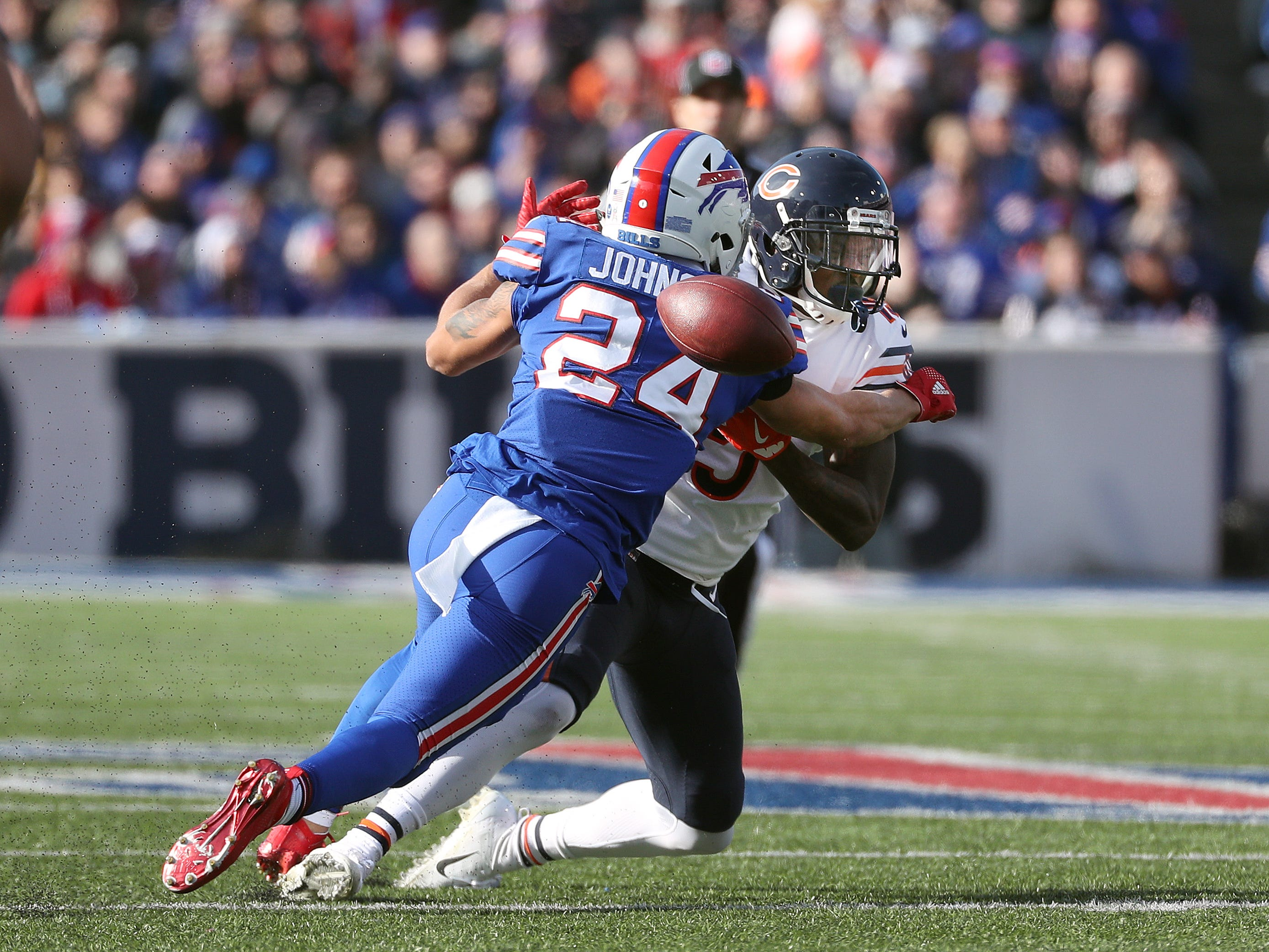 Buffalo Bills defensive back Taron  Johnson breaks up this pass intended for Bears receiver Joshua Bellamy.