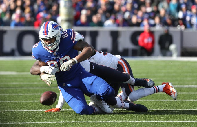 Bills Jason Croom has the ball stripped after a catch.  It was returned for a touchdown by Chicago's Eddie Jackson.  The Bears went on to win 41-9.