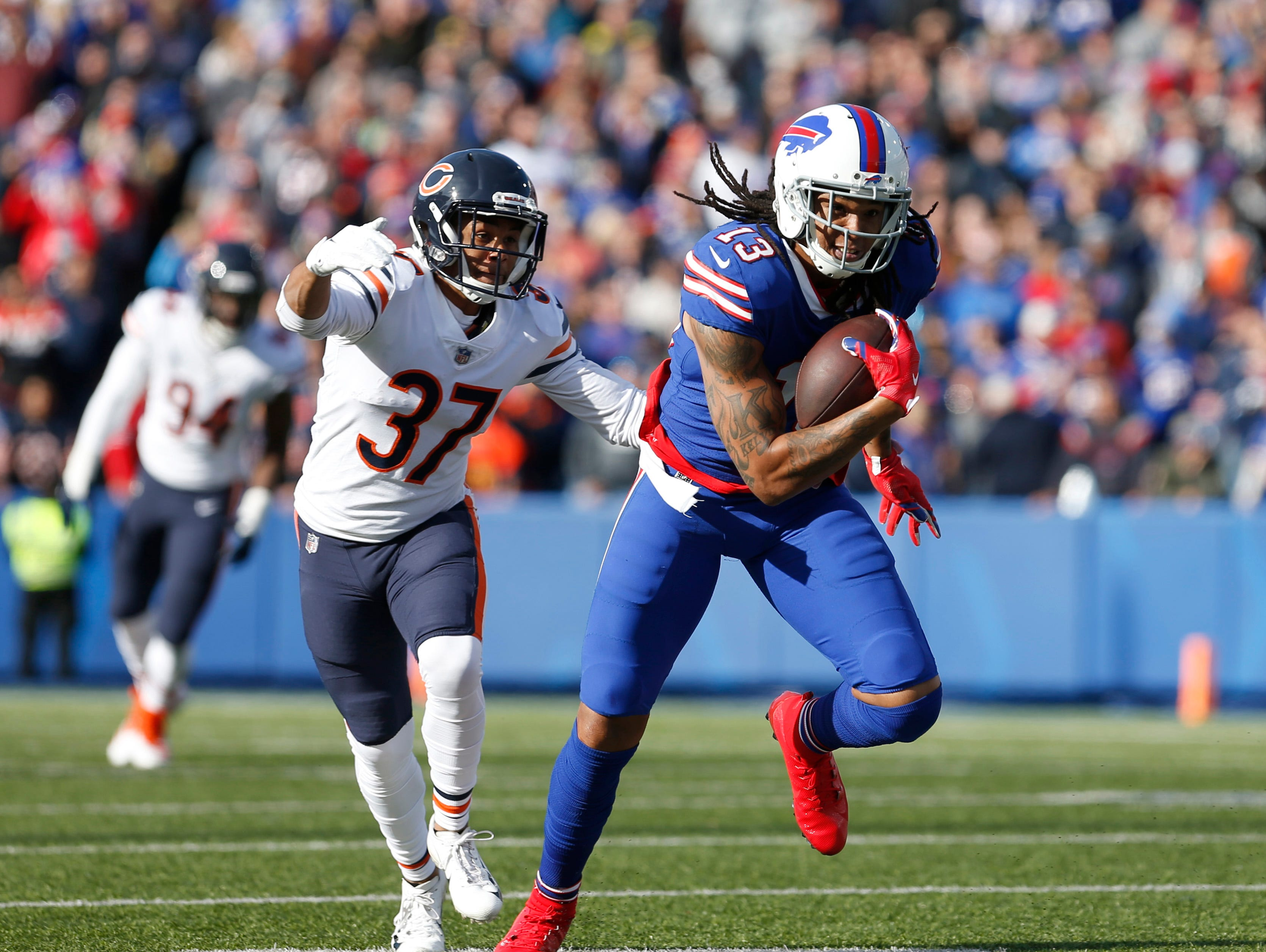 Nov 4, 2018; Orchard Park, NY, USA; Buffalo Bills wide receiver Kelvin Benjamin (13) makes a catch and runs the ball while Chicago Bears cornerback Bryce Callahan (37) looks to make a tackle during the first half at New Era Field. Mandatory Credit: Timothy T. Ludwig-USA TODAY Sports