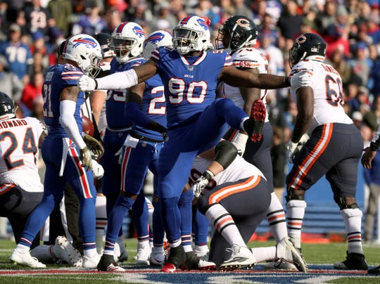 Bills Shaq Lawson celebrates a defensive stop against the Bears.