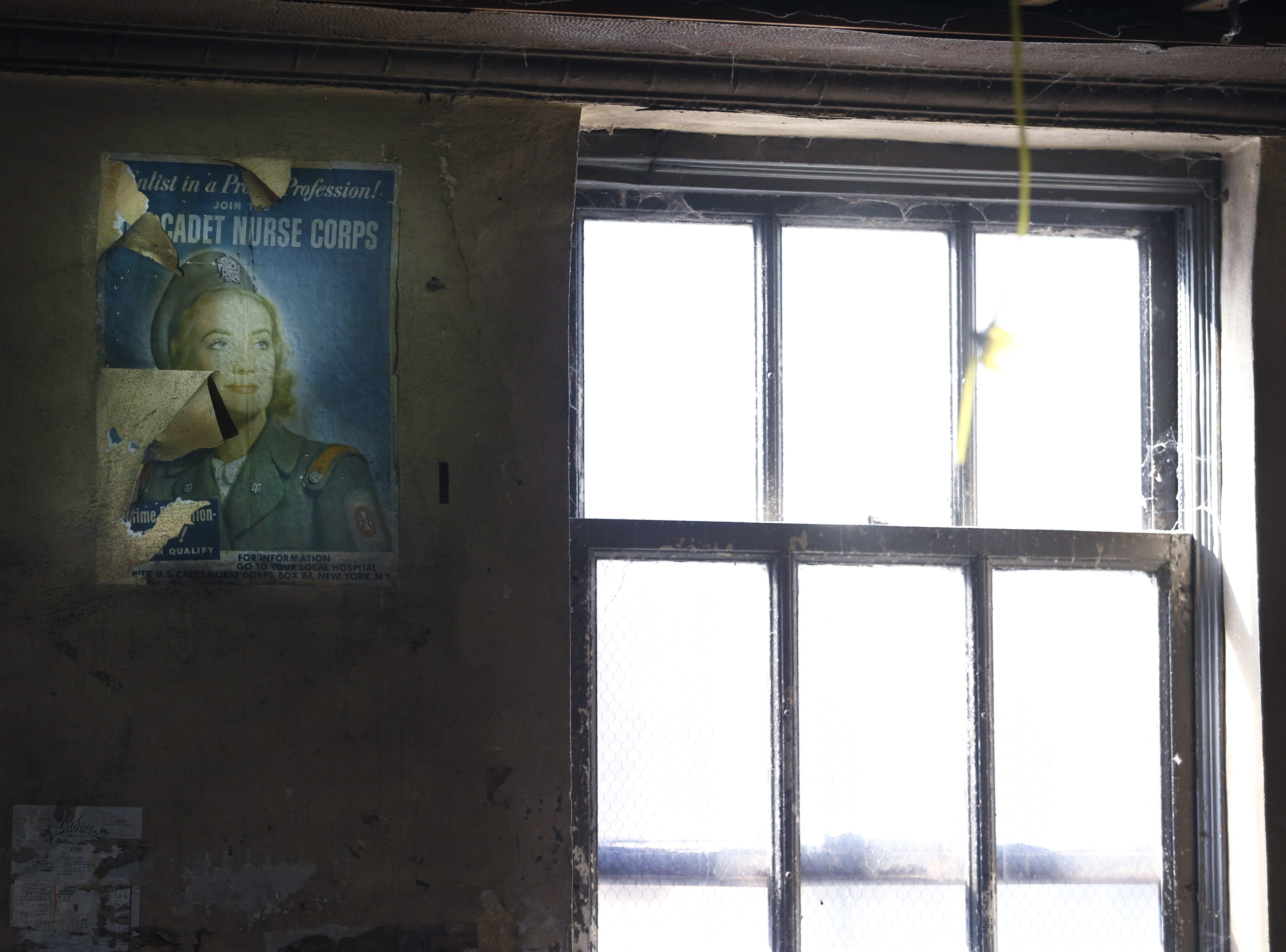 A World War II-era poster still hangs on the wall on an upper floor of the vacant building being redeveloped at 190 E. Main St.