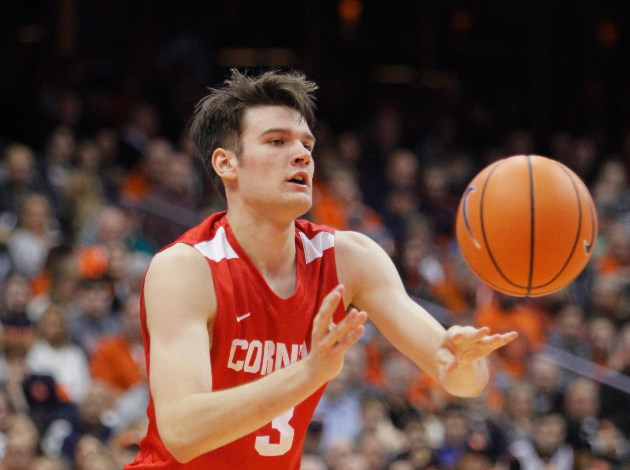 Cornell's Jimmy Boeheim passes the ball in the second half of an NCAA college basketball game against Syracuse in Syracuse, N.Y., Friday, Nov. 10, 2017. (AP Photo/Nick Lisi)