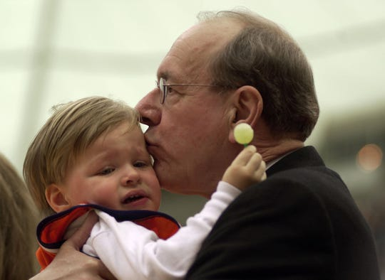 Staff file photo: Coach Jim Boeheim kisses his two year old son Jack moments before the dedication ceremony Sunday, Feb. 24, 2002 at the Carrier Dome.