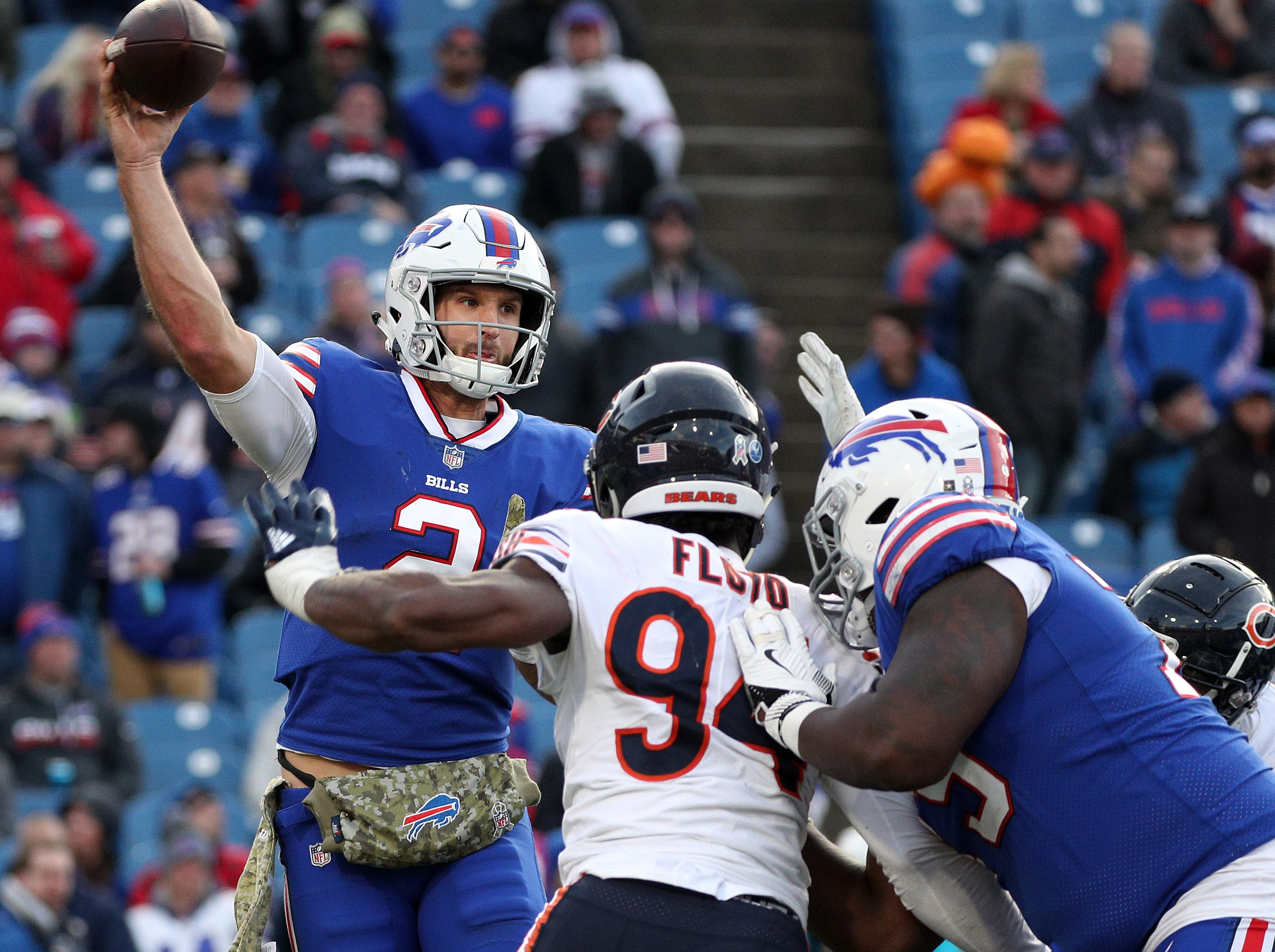 Bills quarterback Nathan Peterman looks for a short pass as he is pressured by Leonard Floyd of the Bears.