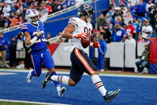Chicago Bears tight end Trey Burton (80) runs past Buffalo Bills' Micah Hyde (23) for a touchdown during the second half of an NFL football game Sunday, Nov. 4, 2018, in Orchard Park, N.Y. (AP Photo/Jeffrey T. Barnes)