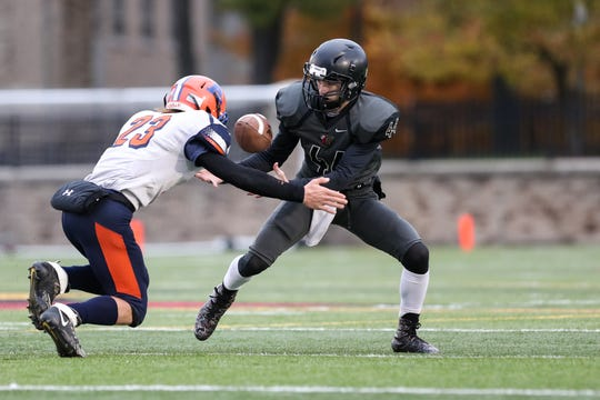 November 3, 2018; Pittsford, NY; USA; Letchworth/Warsaw punt returner Dalton English (44) grabs the ball as he is being hit by Attica's Edward Strzelec (23) during a Section V Class C championship high school football game at St. John Fisher College.  Photo: Christopher Cecere
