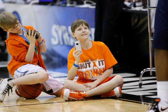 Ten-year-old Jack Boeheim, right, the son of Syracuse head coach Jim Boeheim, and 9-year-old Griff Hopkins, the son of assistant coach Mike Hopkins, watch the team during an NCAA college basketball practice Wednesday, March 24, 2010, in Salt Lake City.