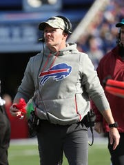 Bills head coach Sean McDermott watches a replay to decide if he should throw his challenge flag.  He put it back in his pocket.