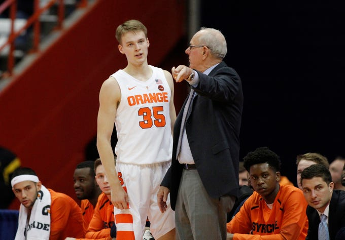 Syracuse head coach Jim Boeheim, right, talks with his son Buddy Boeheim, left, during the second half of an NCAA college basketball game against Saint Rose in Syracuse, N.Y., Thursday, Oct. 25, 2018. Syracuse won 80-49. (AP Photo/Nick Lisi)