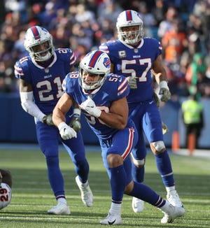 Bills linebacker Matt Milano celebrates a defensive stop.