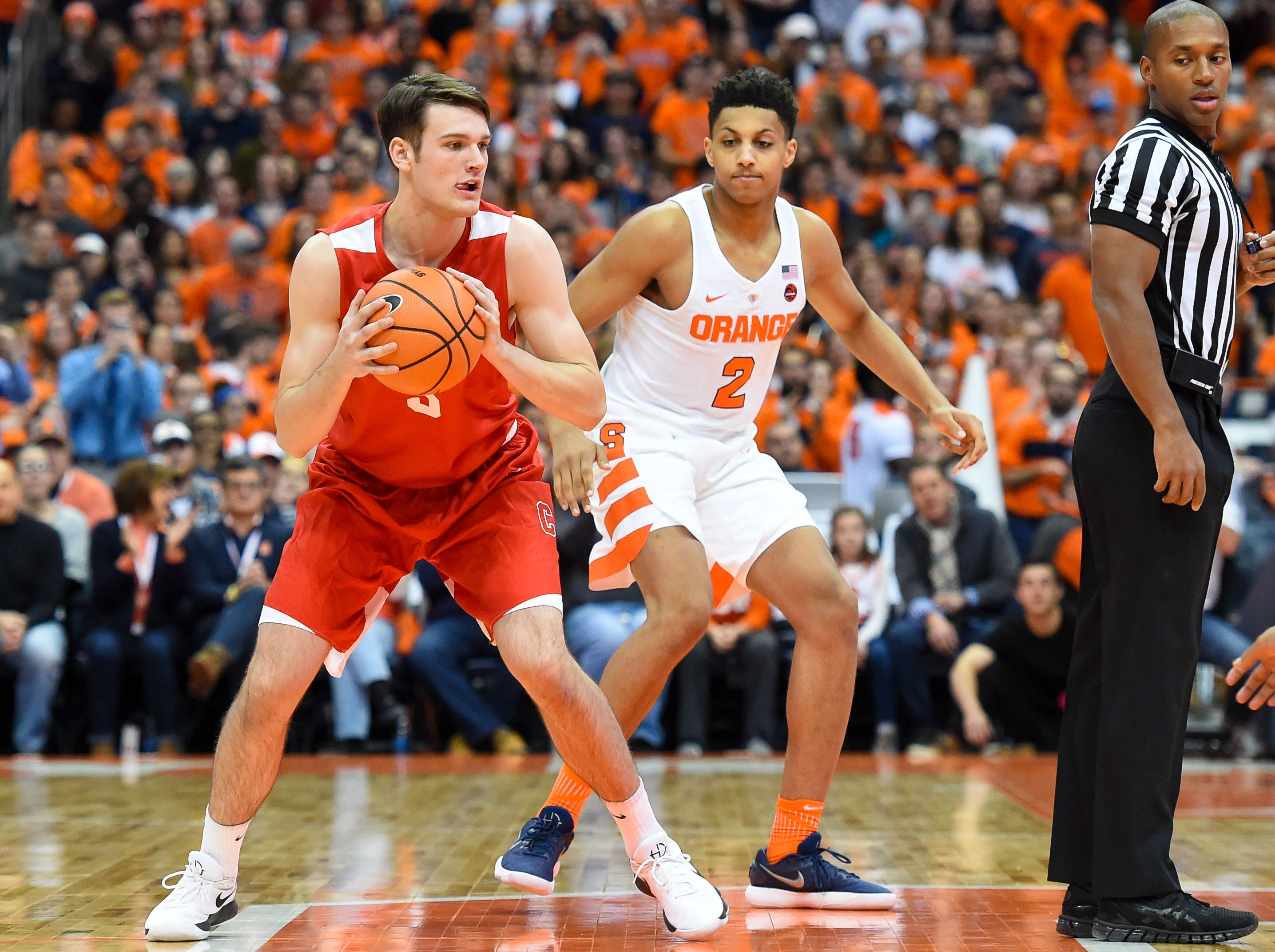 Nov 10, 2017; Syracuse, NY, USA; Cornell Big Red forward Jimmy Boeheim (3) controls the opening tip as Syracuse Orange forward Matthew Moyer (2) defends during the first half at the Carrier Dome. Mandatory Credit: Rich Barnes-USA TODAY Sports