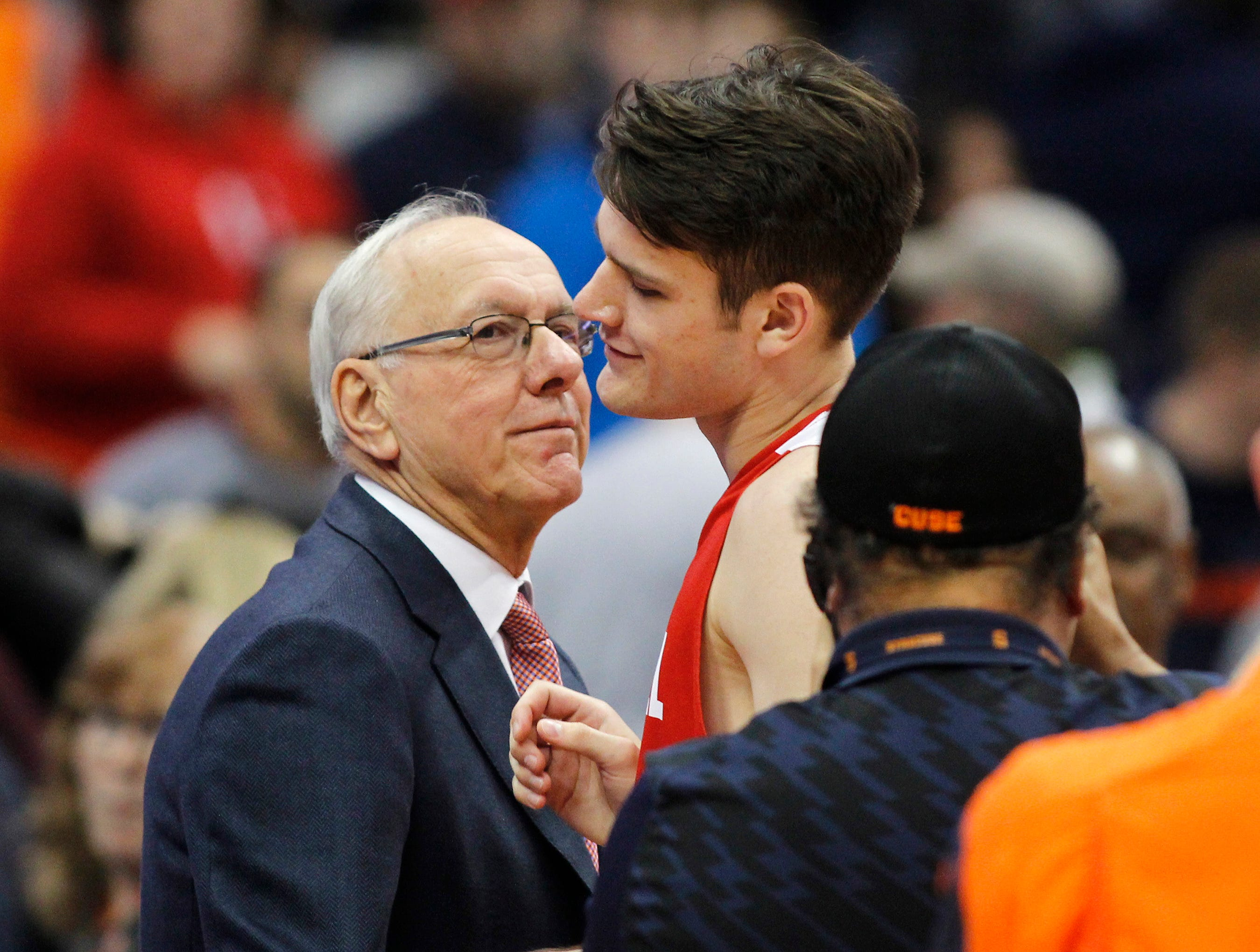 Syracuse head coach Jim Boeheim, left, congratulates his son, Cornell's Jimmy Boeheim, right, at the end of an NCAA college basketball game in Syracuse, N.Y., Friday, Nov. 10, 2017. (AP Photo/Nick Lisi)
