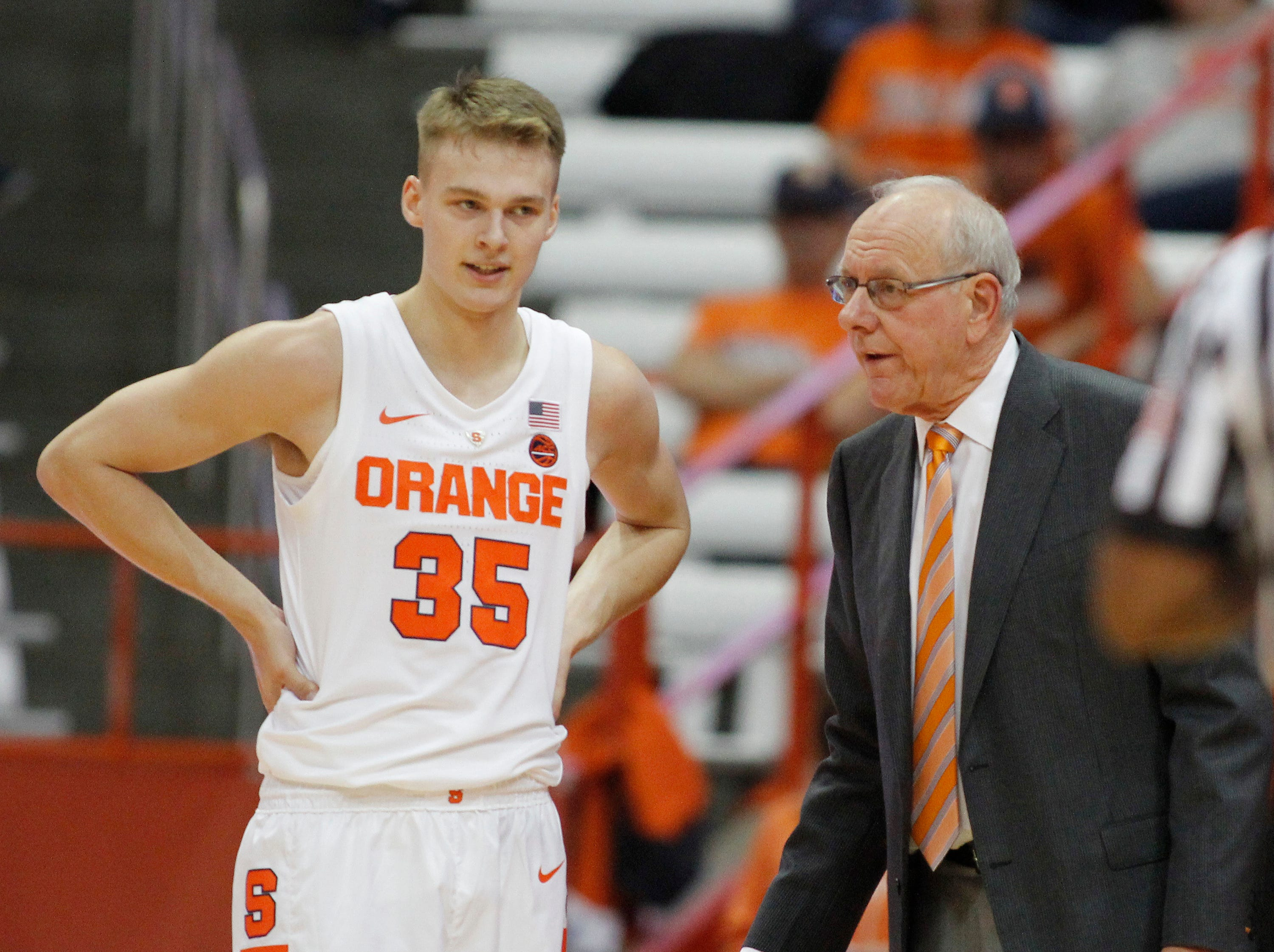 Syracuse coach Jim Boeheim, right, talks to his son Buddy Boeheim, left, during the first half of the team's college basketball exhibition game against Le Moyne in Syracuse, N.Y., Wednesday, Oct. 31, 2018. (AP Photo/Nick Lisi)
