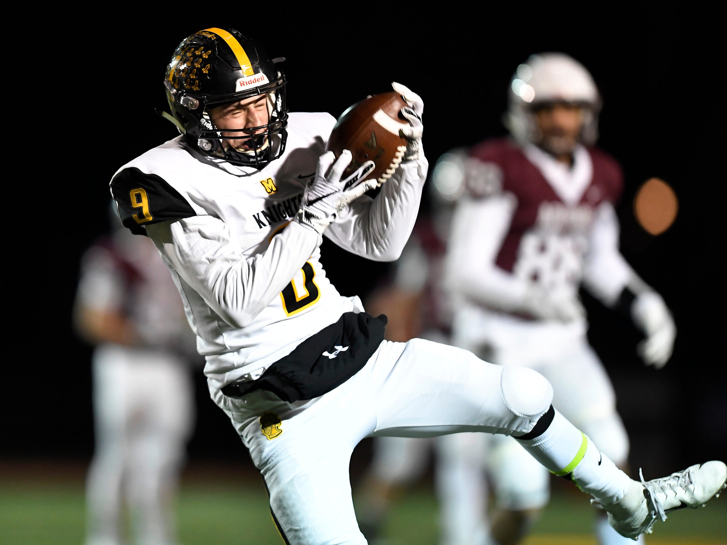 McQuaid's Ben Beauchamp intercepts a pass by Aquinas' Tyler Szalkowski during the Section V Class AA championship game at SUNY Brockport, Saturday, Nov. 3, 2018.