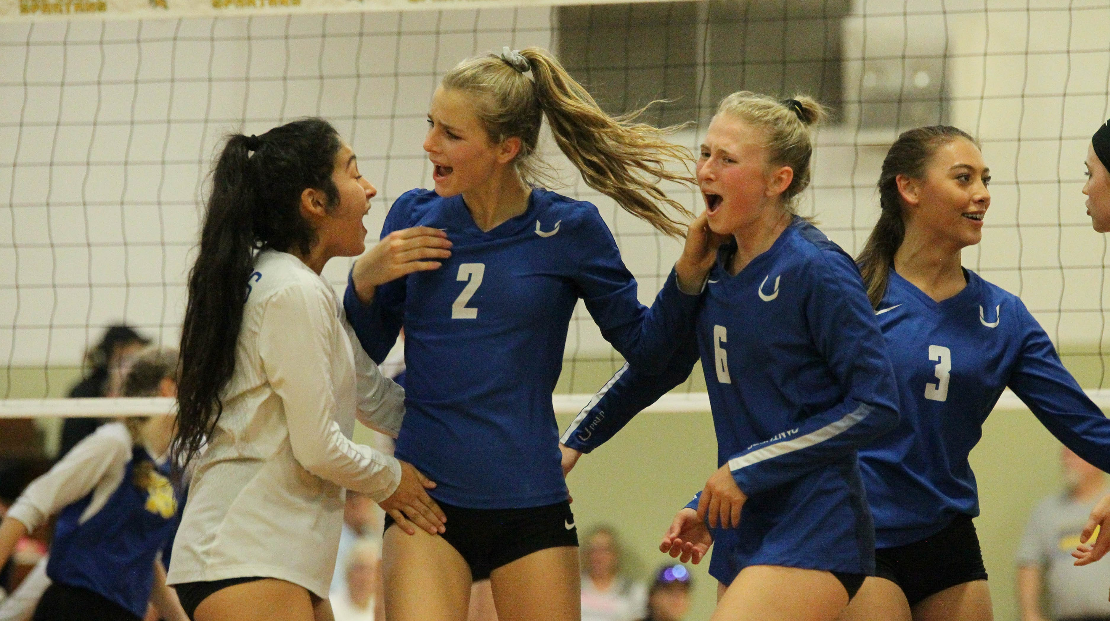 From left: Gigi Elizarraras, Madison Kremer, Emily Cox and Kaleia Mizuta celebrate a point during the Division IV Northern Section volleyball championship on Saturday, Nov. 3. Pierce won the match in three sets over U-Prep, 25-23, 25-21, 25-22.