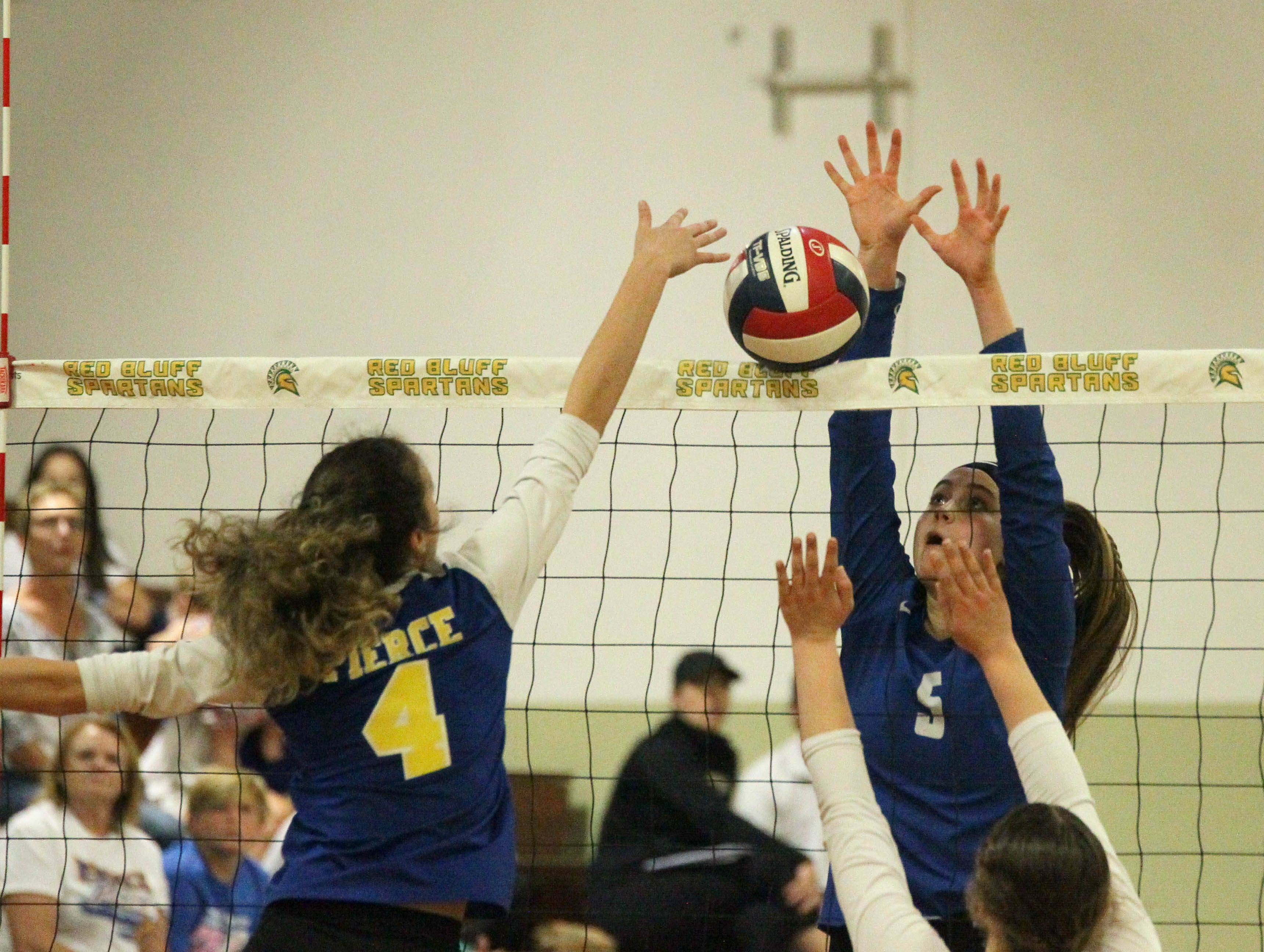 Madi Friebel (5) attempts to block a shot by Pierce in the Division IV Northern Section volleyball championship on Saturday, Nov. 3. Pierce won the match in three sets over U-Prep, 25-23, 25-21, 25-22.