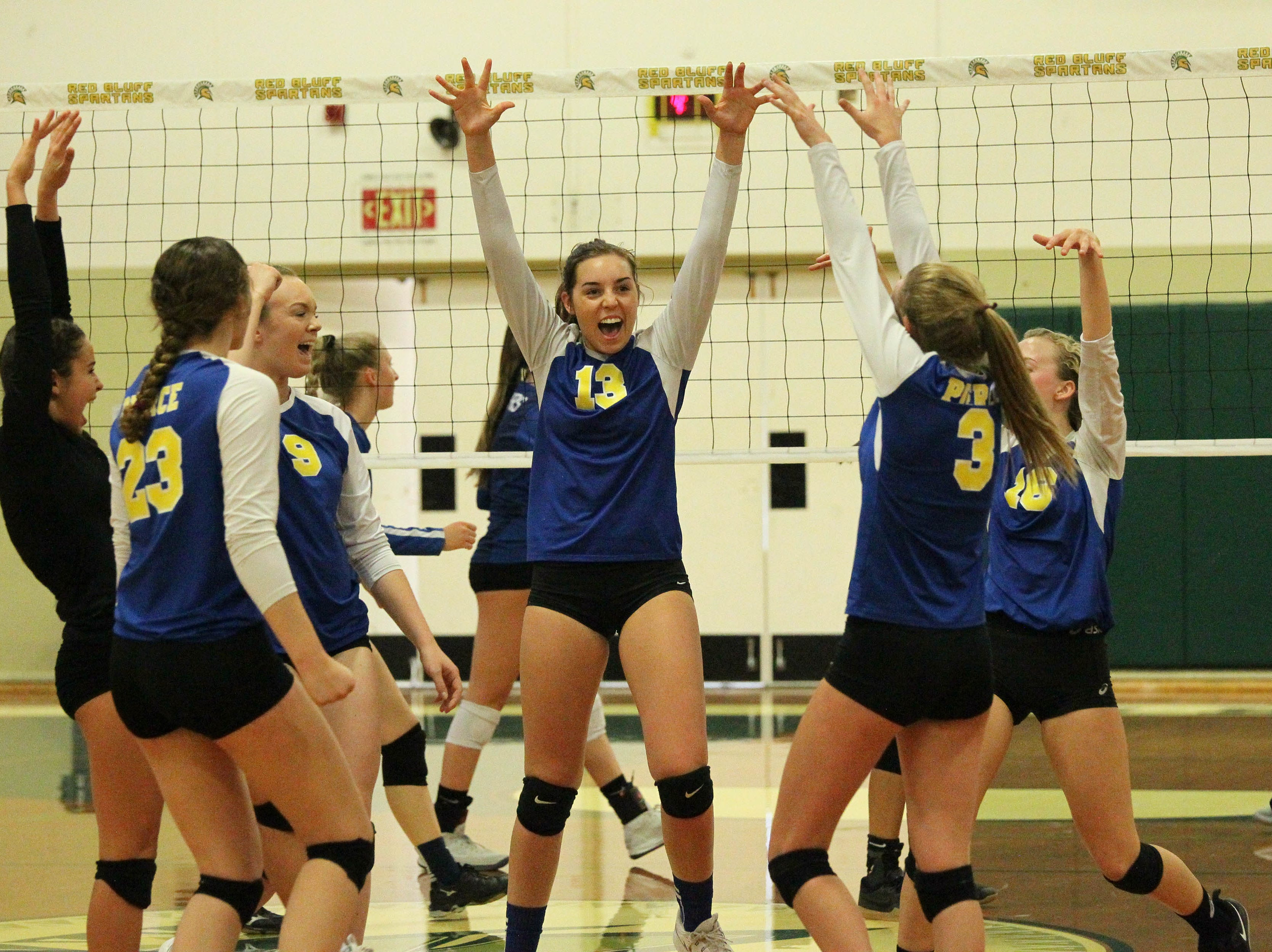 Pierce junior Halle Charter (13) celebrates a point in the Division IV Northern Section volleyball championship on Saturday, Nov. 3. Pierce won the match in three sets over U-Prep, 25-23, 25-21, 25-22.