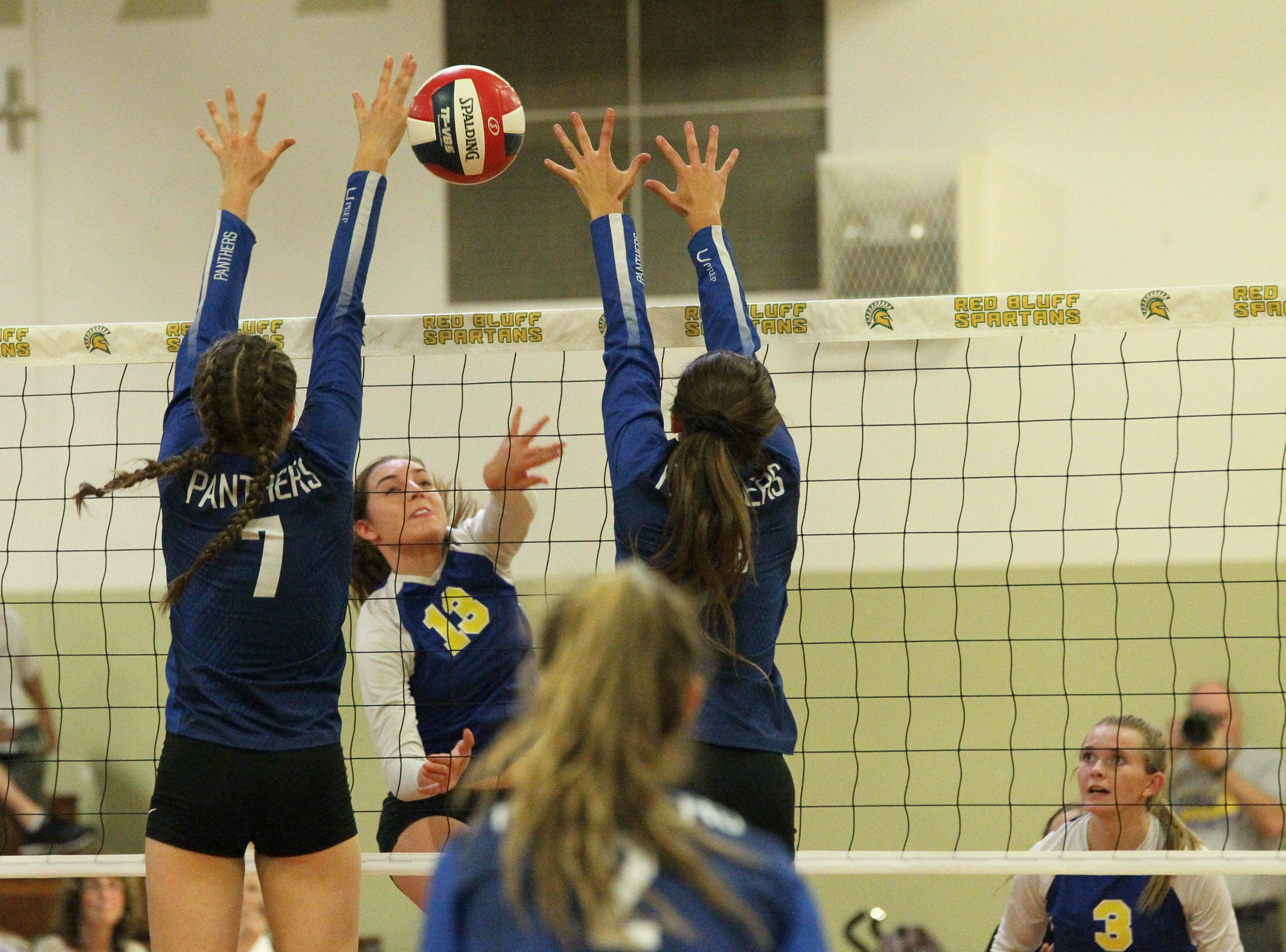 U-Prep junior Kennedy Kremer (7) attempts to block a shot by Pierce junior Halle Charter (13) in the Division IV Northern Section volleyball championship on Saturday, Nov. 3. Pierce won the match in three sets over U-Prep, 25-23, 25-21, 25-22.
