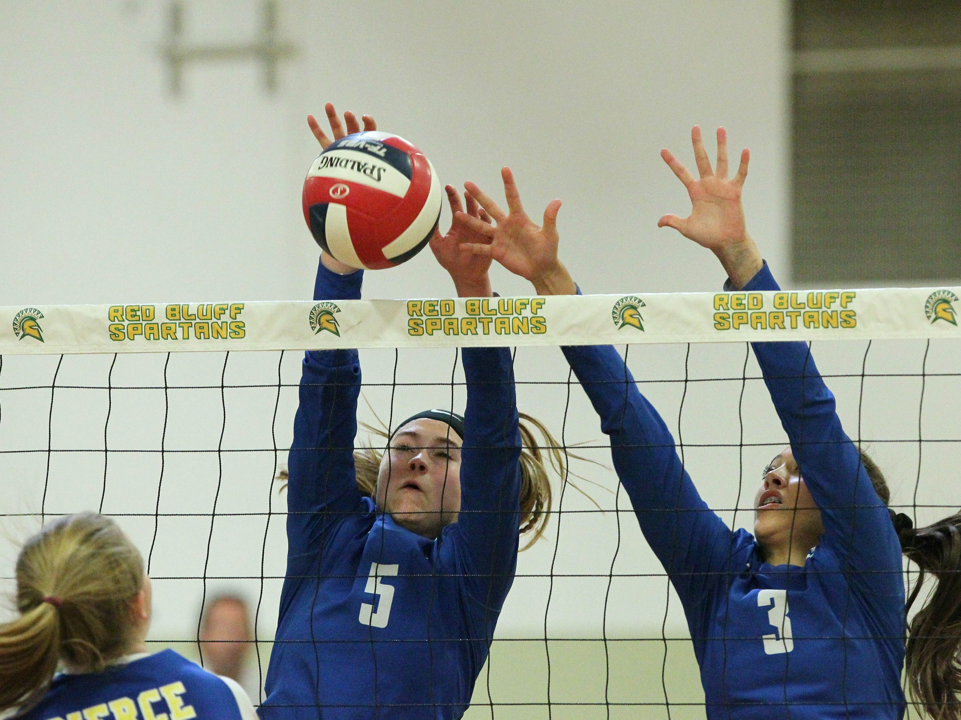 U-Prep's Madi Friebel (5) and Kaleia Mizuta (3) attempt block a shot by Pierce in the Division IV Northern Section volleyball championship on Saturday, Nov. 3. Pierce won the match in three sets over U-Prep, 25-23, 25-21, 25-22.