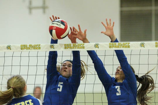 U-Prep's Madi Friebel (5) and Kaleia Mizuta (3) attempt block a shot by Pierce in the Division IV Northern Section volleyball championship on Saturday, Nov. 3, 2019. Pierce won the match in three sets over U-Prep, 25-23, 25-21, 25-22.