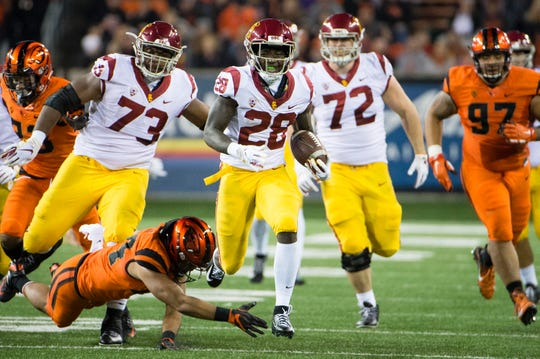 Nov 3, 2018; Corvallis, OR, USA; USC Trojans running back Aca'Cedric Ware (28) scores a touchdown during the first half against the Oregon State Beavers at Reser Stadium. Mandatory Credit: Troy Wayrynen-USA TODAY Sports